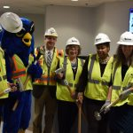 Turn Renovations team posing with Whoot and President Jim H